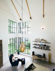 Modern farmhouse, Austin Texas A corner with 18-foot-high windows brings in views. Industrial Living Room by PAVONETTI Office of Design