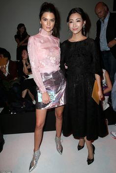 Fashionable friends: Kendall cosied up to her fashionable friend Wen Ya after the cat walk...