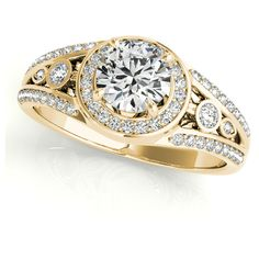 This unique antique inspired engagement ring has an antique touch that can be seen in the carvings underneath the ring's band and mounting. Crafted in 14k Yel…