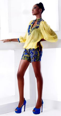 African print shorts with lightweight blouse.