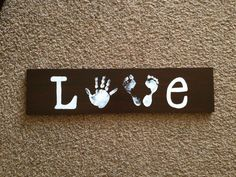 LOVE sign using a piece of 1 x 6 and my sons hand and daughters feet.