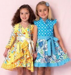 These sweet girls' dresses are made with a mix of three different fabrics to create a one of a kind look. Dresses have lapped fronts with faced neckline, pleated skirt, thread belt loops at the waist, ruffles at hem and center back zipper. Kwik Sew K0199, Girls' Dresses and Sash sewing pattern.