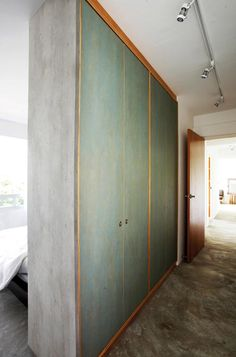 Wardrobe as a partition saves space, save cost and give privacy to sleeping area