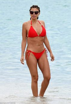 Sexy suit! Larsa Pippen flaunted her svelte curves in a skimpy red string bikini as she paraded around the beach in Miami, Florida on Friday