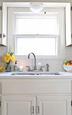 Like the upper panel below the sink.   Elsie Larson's Kitchen Tour!