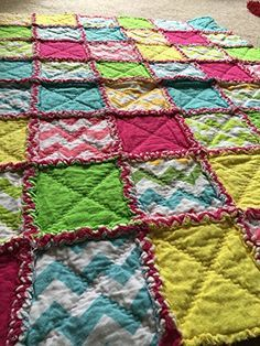 I love this tutorial. Each step has a video to walk you through it - perfect for beginners! Rag quilts are so great to snuggle under.