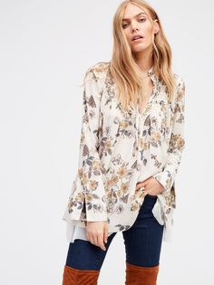 So Fine Printed Smocked Top   Silky printed top with a front and back smocked detail around the neckline. Flowy silhouette with bottom lining for a softly layered look. Retro-inspired bell-shaped sleeve cuffs with vents. Front ties feature subtle bead accents.