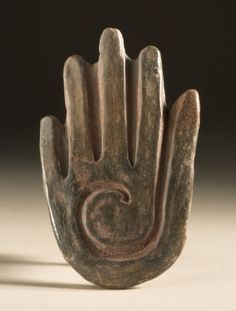 A hand-shaped stamp. Olmec, fromPuebla, Mexico.1000-600 BC.Artefacts courtesy of, and can be viewed at the LACMA. Via their online collections:M.83.217.7.