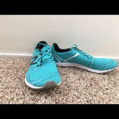 New balance minimus size 7.5 Super cute new balance shoes that are teal with white and black trim. Definitely the kind of shoe that has a very flat sole, good for weight lifting. Or those runners who like a flat surface! New Balance Shoes Athletic Shoes
