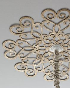 Scrolled Ceiling Medallion (Horchow) - this is an easy DIY project - paint an inexpensive metal wall medallion & secure it to the ceiling to highlight a hanging light fixture.