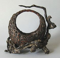Late Meiji hand-crafted Japanese Ikebana bamboo flower basket on knotted root base ca 1900. The piece is from the Thomas Buechner (1926-2010) Estate.