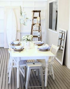 love all the natural elements and colors at play here with the white.  Note to self: gotta get a white lantern