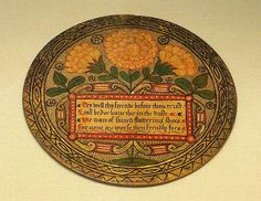 Trenchers - Tudor (Decorated trenchers (circular mats or plates, made of sycamore or beechwood) were especially popular for the wealthy in Elizabethan England. Delicacies such as marzipan or crystallized fruit were set out on the plainside. Turned over after the meal, the mottos on the front were the source for amusing games) by Kotomicreations, via Flickr