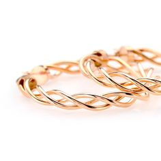 Loving these rose gold hoops. The color is so flattering on every skin tone. | 14k Rose Gold Twisted Tube Hoop Earrings