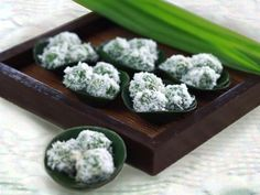 Indonesian Dessert - Klepon Ingredients: 1½ cups glutinous rice powder ¾ cup lukewarm water 2-3 drops green food coloring 8 tablespoon grated Java dark brown sugar 1 cup fresh-grated coconut, mixed with ½ tablespoon salt