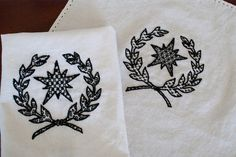 Blackwork Cup Covers  Stem stitch outline, various blackwork fills.  DMC #8 pearl cotton