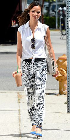 JAMIE CHUNG Maybe it's because it's just too sweltering for jeans, but we're really crushing on silky printed pants this week. If Gwen's are too edgy for your taste, opt for a looser fit as seen on Jamie's Parker pair (worn with blue heels and a Lancaster Paris bag). Wear them with a button-down tucked in for work, then tie it at the waist as soon as you leave the office for happy hour.
