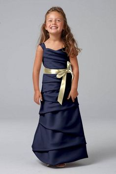 Miniature Bridesmaid with a navy dress and yellow sash or can do a white/ivory