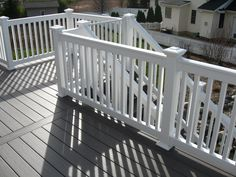 Here is our Passport Decking in London Grey. White railings go perfect with this deck! #Gossen #Deck #WePerform