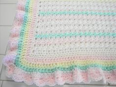 Hand crocheted baby blanket afghan pink, lavender, yellow, green, white with pink shell border made with lightweight soft baby sport yarn by AuntieJenniesAttic on Etsy