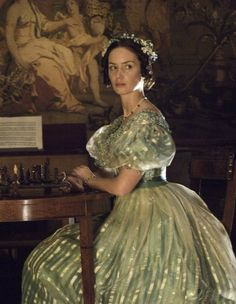 """Emily Blunt as Queen Victoria in """"The Young Victoria"""" (2009). The shimmering material and colors of this dress is eye-catching"""