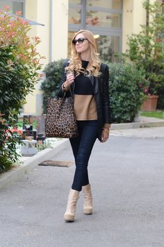 Love this two-tone, black and beige sweater.