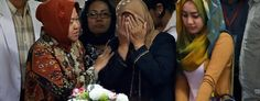 A relative weeps during the handover of the body of Hayati Lutfiah Hamid, one of the victims of AirAsia Flight 8501. (Dita Alangkara/AP)