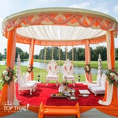 Beautiful Coral, Orange & Ivory Mandap Details from our wedding this August at @cherrycreekweddings golf Club and Banquet Center with Florals, a Crystal Panel, Statues, Furniture, staging, and loads of elegant fabric swagging- with @randi.brandt