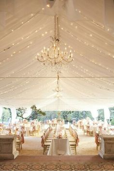 Reception with hanging lights and draps with a stunning hanging chandelier♡
