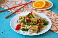 Brighten your Meatless Monday meal with this flavorful recipe for orange-ginger tofu stir fry. The flavors are delightful, together with tofu and vegetables!