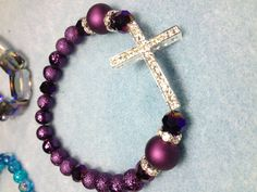 Purple passion pave cross bracelet with pave spacers. I made this one for a purple lover.