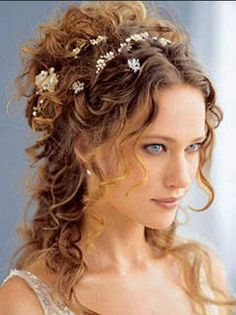 I like the little gems included in the half up half down curly hair-do!