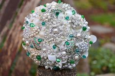 Absolutely Amazing Emerald and SIlver Brooch Bouquet.    Emerald and pearl jewel encrusted bouquet -- deposit on a made to order brooch wedding bridal bouquet. $315.00, via Etsy.