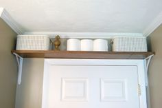 My So-Called Home: Organized Storage in Our Small Bathroom. over-the-door storage stylishly organized