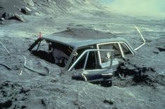 The remains of a car buried in ash after the eruption of Mt. St. Helen, 1980