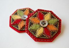 brooches - or make several and stitch together for a candle mat - would have to ditch the button unless you just used them on the outside and a large one int the center.