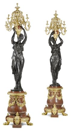 A pair of large French gilt-bronze-mounted bronze and red marble candelabra, 20th century.