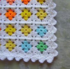 granny square afghan with bright centers and pretty edging crochet de un solo color con blanco