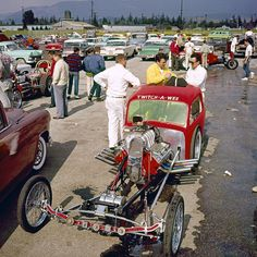 """1962 Winter Nationals - Lonnie Butts packs the chute for the """"Twitch-A-Wee"""" Competition Coupe."""