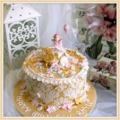 Gold cake Stenciled sides handmade flowers and fairy