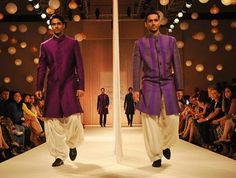 Manish Malhotra designed two-tone kurtas, some with stripes, others simply plain that were teamed with wide salwars, dhotis or dhoti pants.