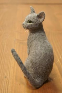 felt sculpture ... this is scarier than the rabbit statue my mom has in her flower bed o_O