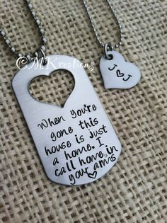 Hand stamped dog tag with cut out heart his and her necklace stainless steel military long distant relationship. $27.00, via Etsy.