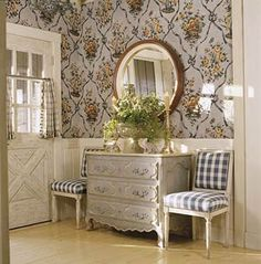 I like the idea of a dresser, two chairs, and a mirror or art in the front entry.