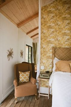 Ladder stairs lead from there up to a trapdoor into the interior, where visitors find a bamboo-finished room with another bed. #TinyHouseforUs