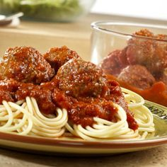 Seasoned meatballs are microwaved with traditional pasta sauce and served over hot spaghetti.