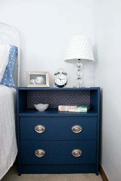 If you want a nifty cubby for your bedtime reads, swap a drawer for an extra piece of wood like this elegant cupboard.  Get the tutorial at Cleverly Simple »