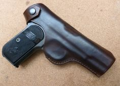 Custom made leather belt carry holster for classic Colt 1903 / 1908 hammerless pocket pistol - hand crafted by makeitjones.co.uk. Available in a range of carry options and 18 custom colours.