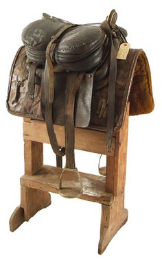 """A GENUINE COSSACK HORSEMAN'S SADDLE. This saddle was the property of White Russian emigre Boris Michael d'Adamovich Leliwa, who left Russia in 1920 in the wake of the Russian Bolshevik Revolution. According to Russ Bigelow, Leliwa lived  in a """"shack"""" in Richmond, New Hampshire. 1947 newspaper article where he appeared at a public meeting to advocate the use of dogs in hunting mountain lions, which were then menacing domestic animals in Winchester."""