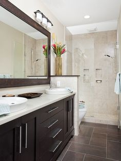 I like the little wall at the end of the counter.  Makes a nice separation of the sink vs. shower areas.
